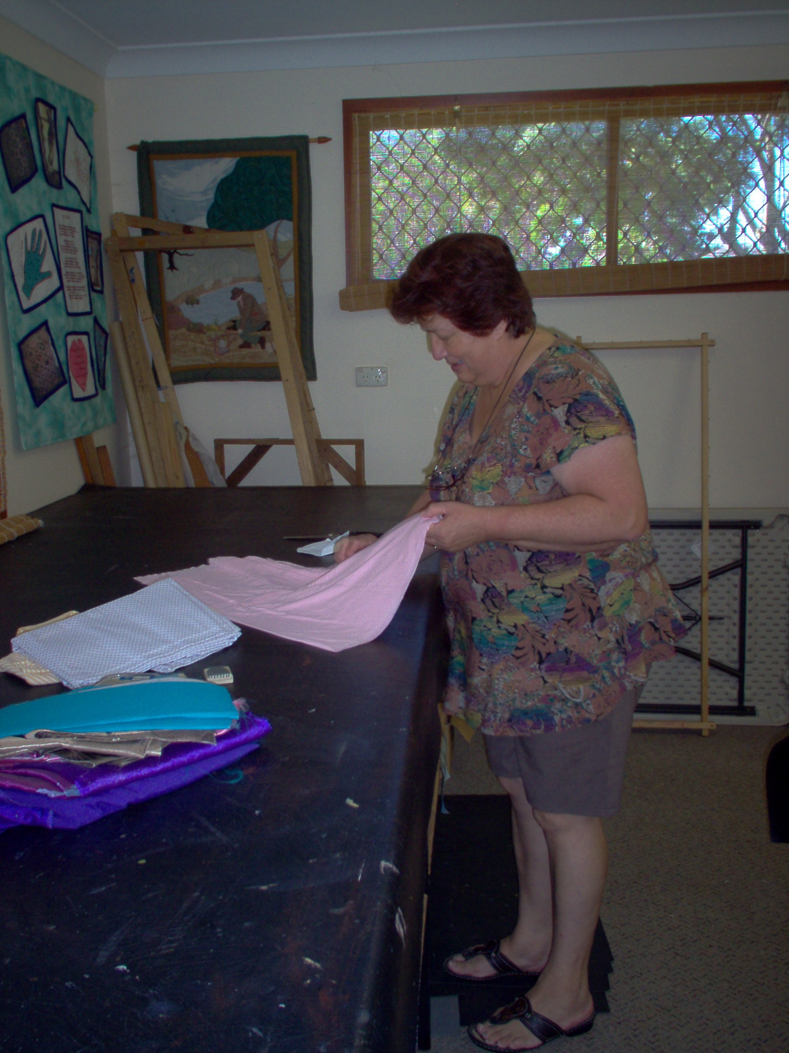 member preparing material for sewing