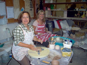 pottery students at the wheel