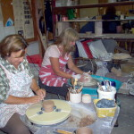 pottery students working at the wheel