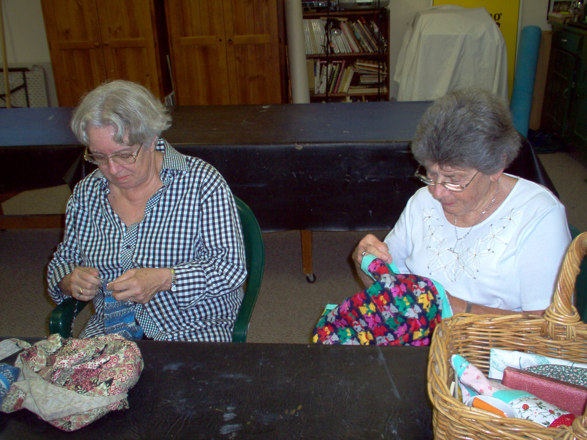 two members sewing separate pieces