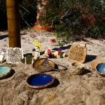 pottery displayed in a garden